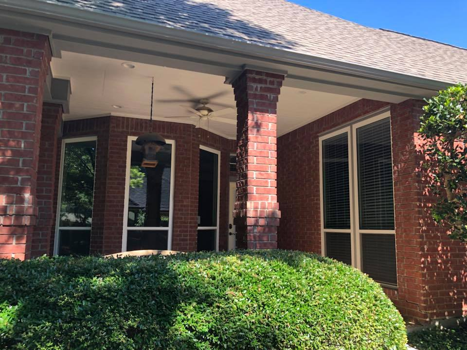 brick house with energy star replacement windows